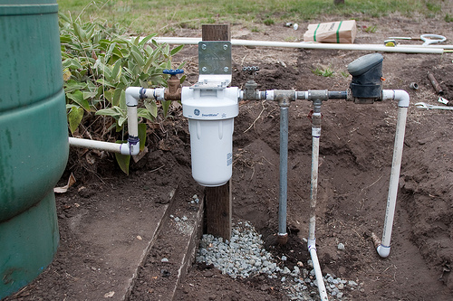 The whole house water filter is hooked up to the well and lines to the house and for irigation. (saving water project)